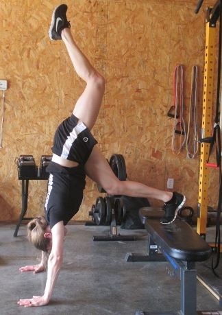 Make a pike push-up harder by extending a leg.